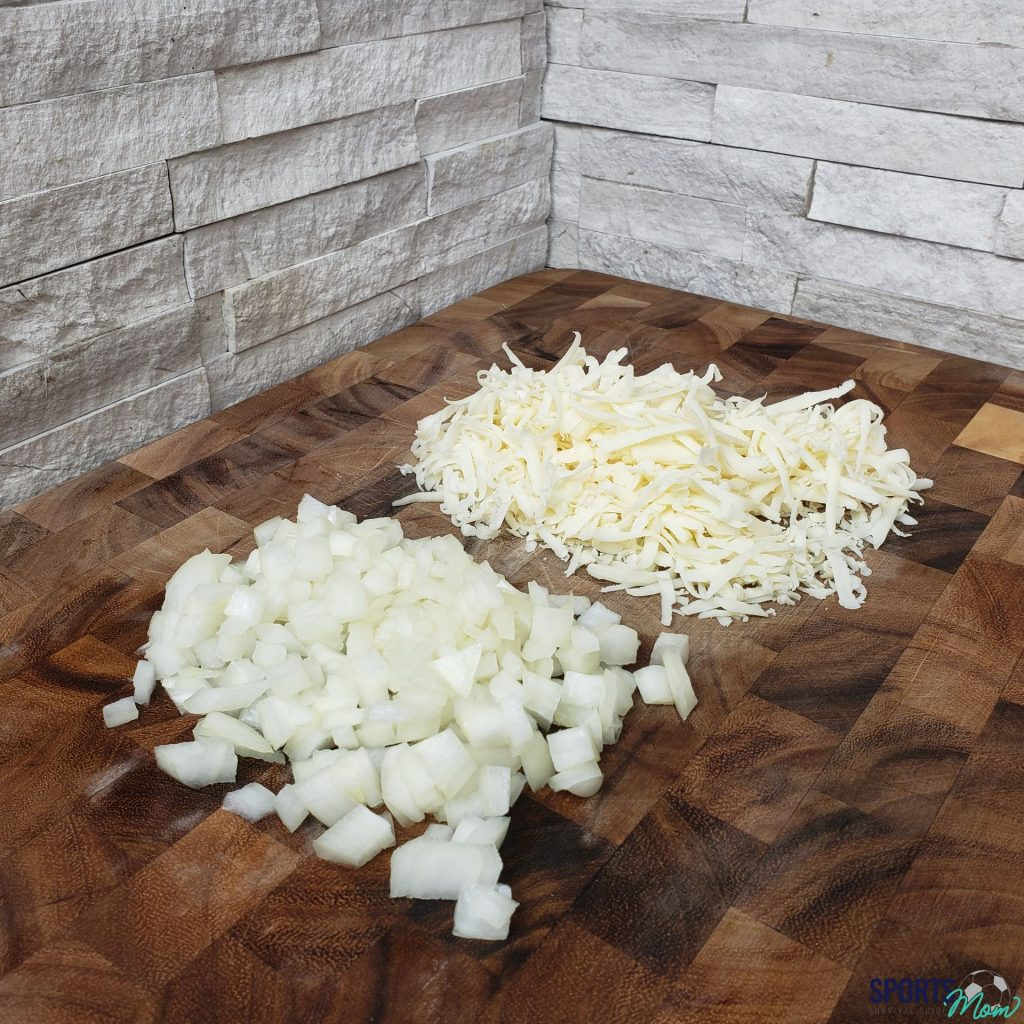 Step one: cut onions and grate cheese