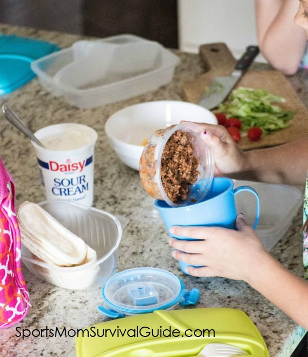 Do you and/or you kids get tired of the same lunches every week?  Give this Taco Bowl Take-n-Make a try.  They are easy to put together and a fresh take on the traditional Lunchable!