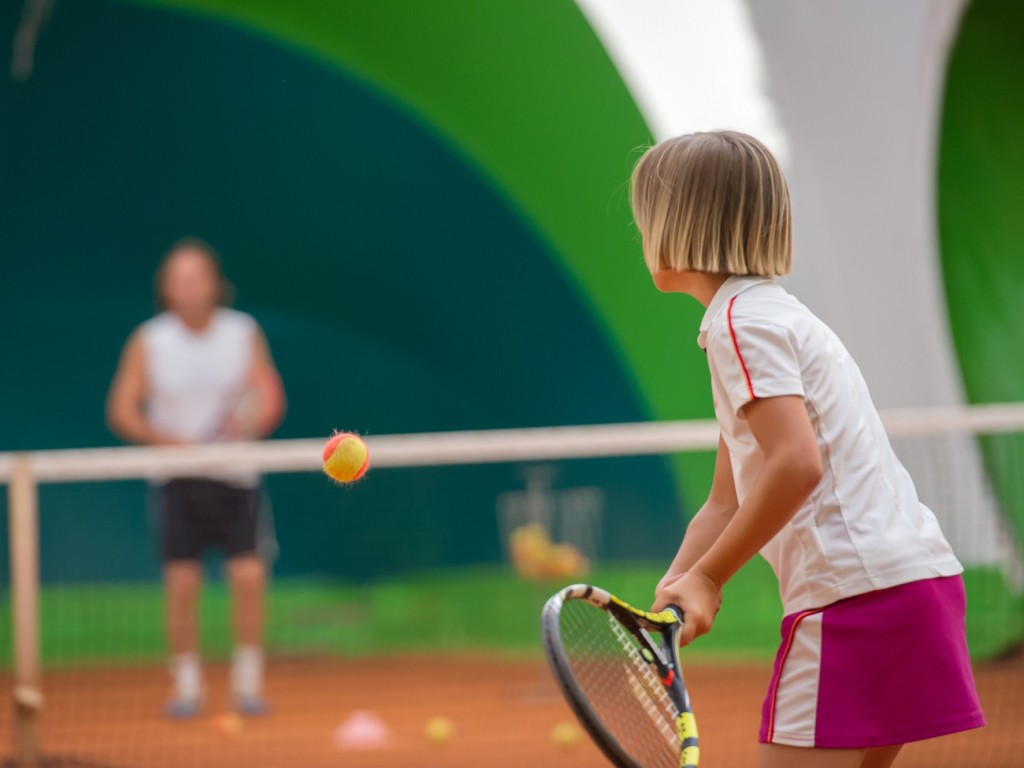 Young Child Playing Tennis
