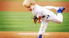 baseball player in blue cleats - 1