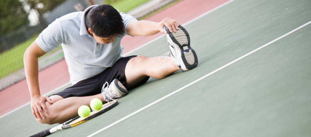 Young Tennis Athlete Stretching on the Court