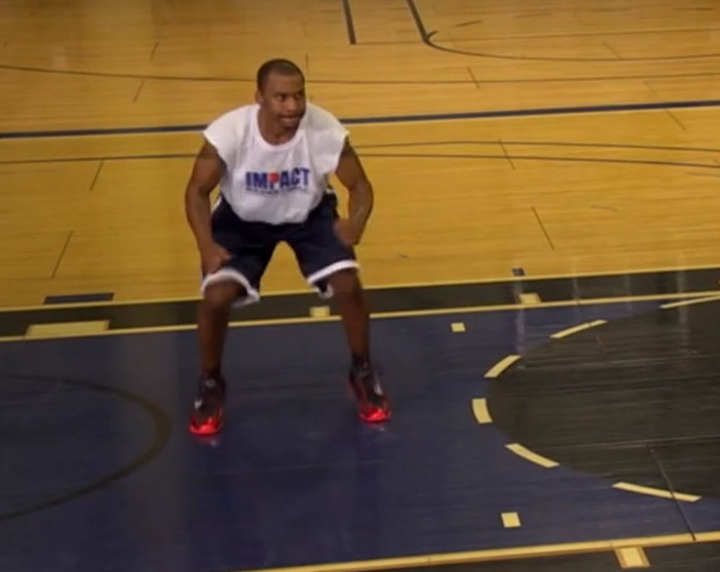 basketball player crouching