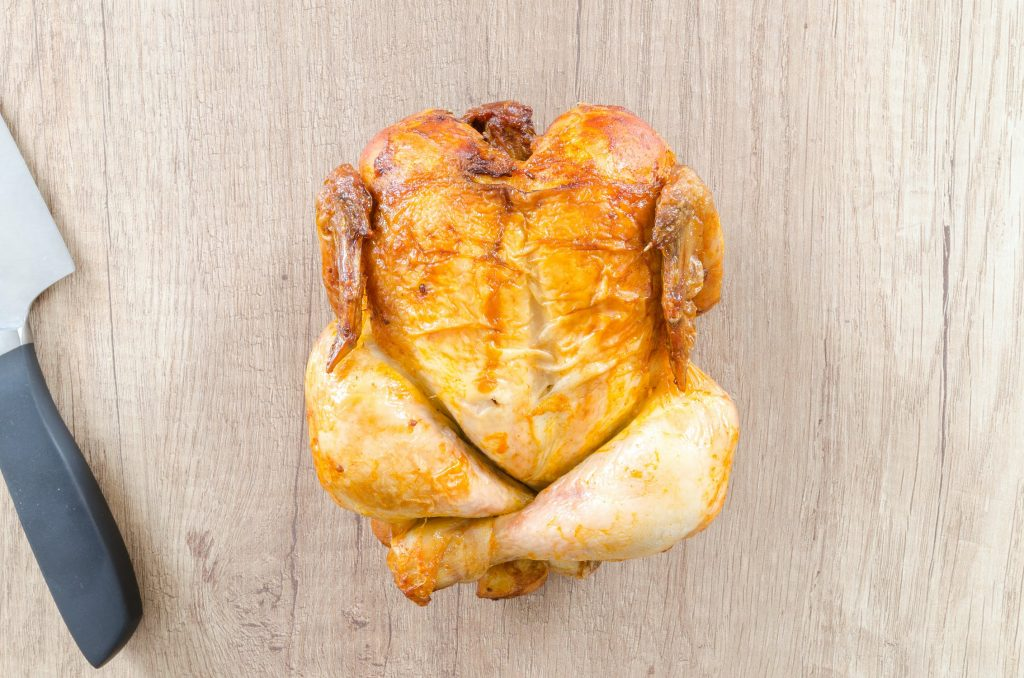 Oven roasted chicken on a cutting board