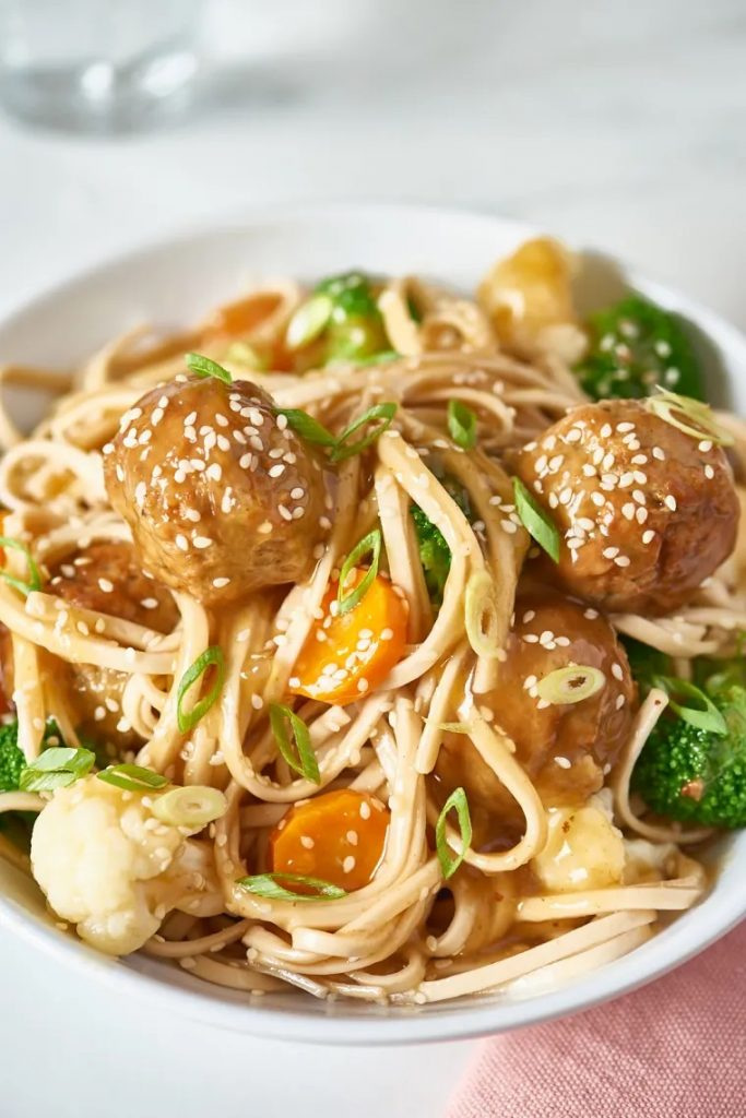 Bowl of pasta with meatballs and vegetables