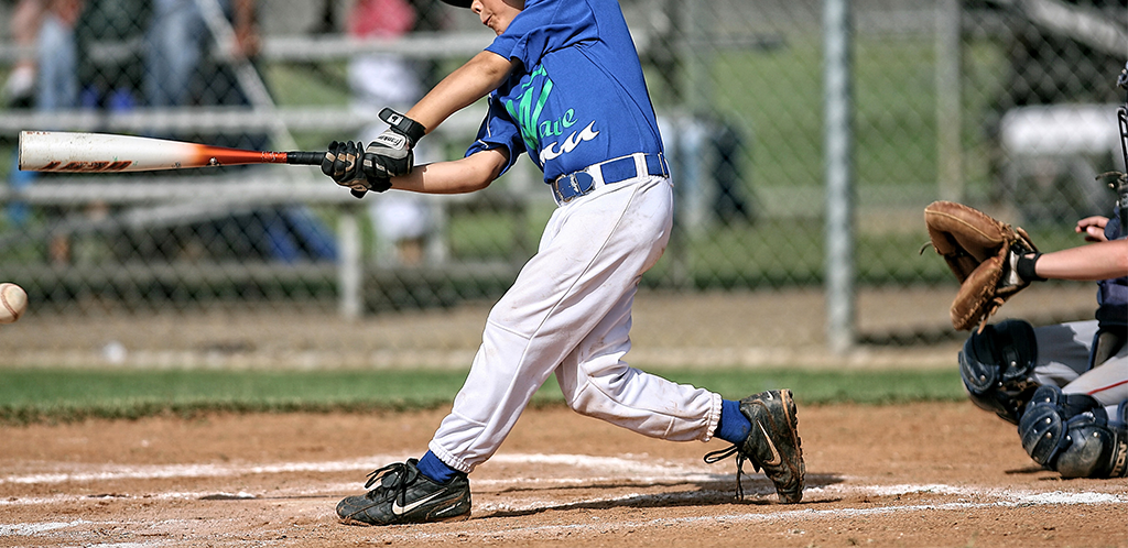 boy playing baseball in dirty black shoes
