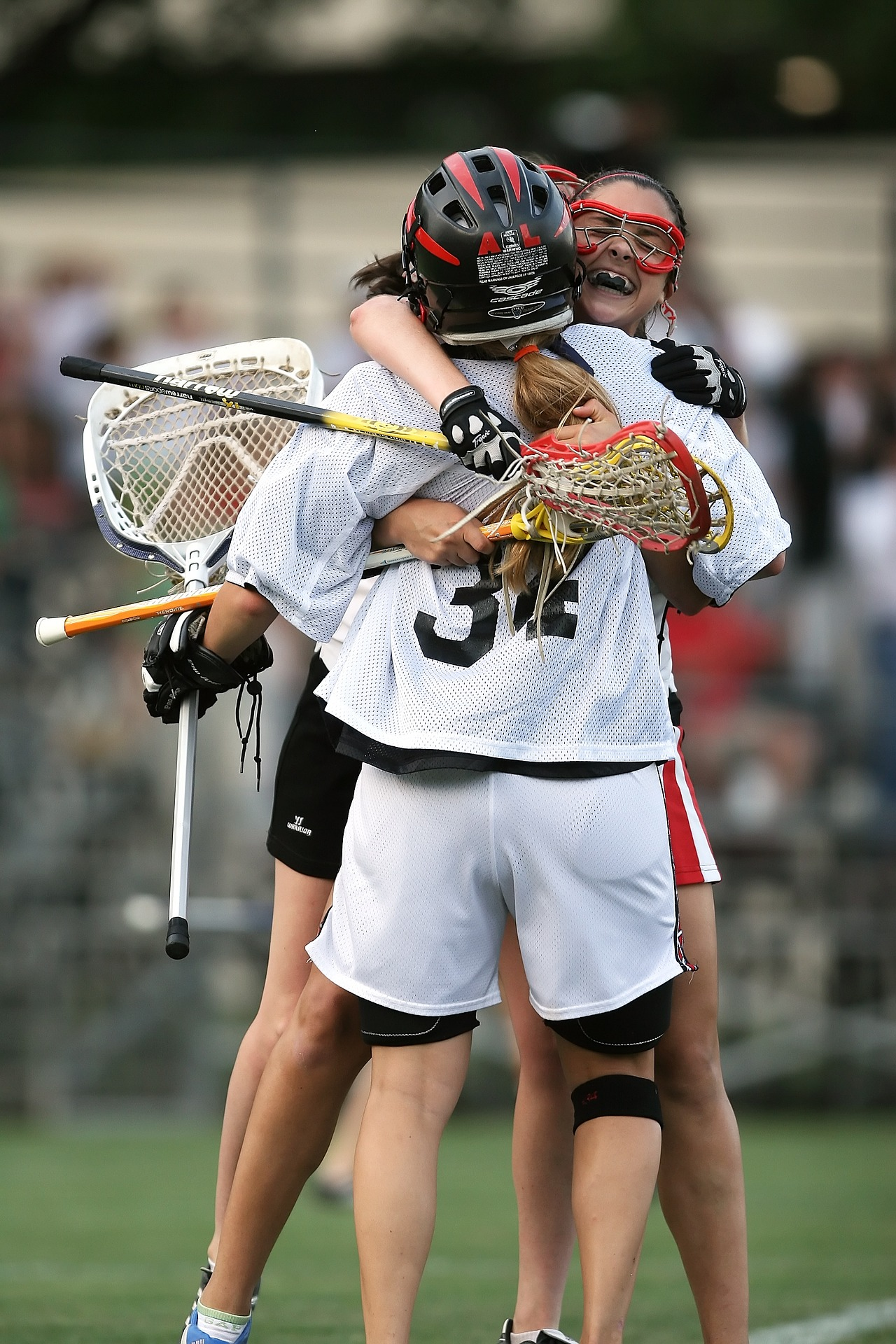 Girl Lacrosse Players celebrate on the field