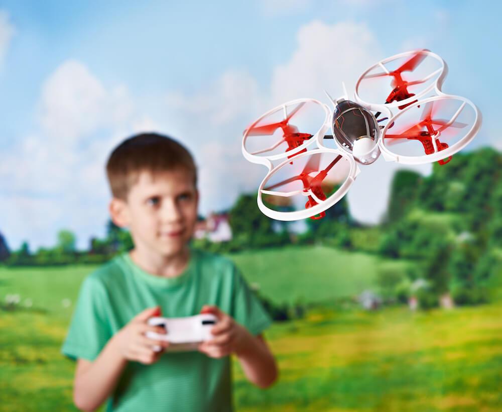 Kid flying a mini drone