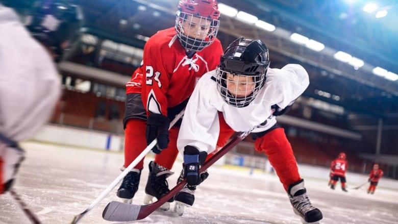 Boys playing hockey