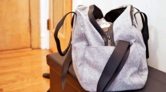 A view of a grey sports bag on a bench in a room